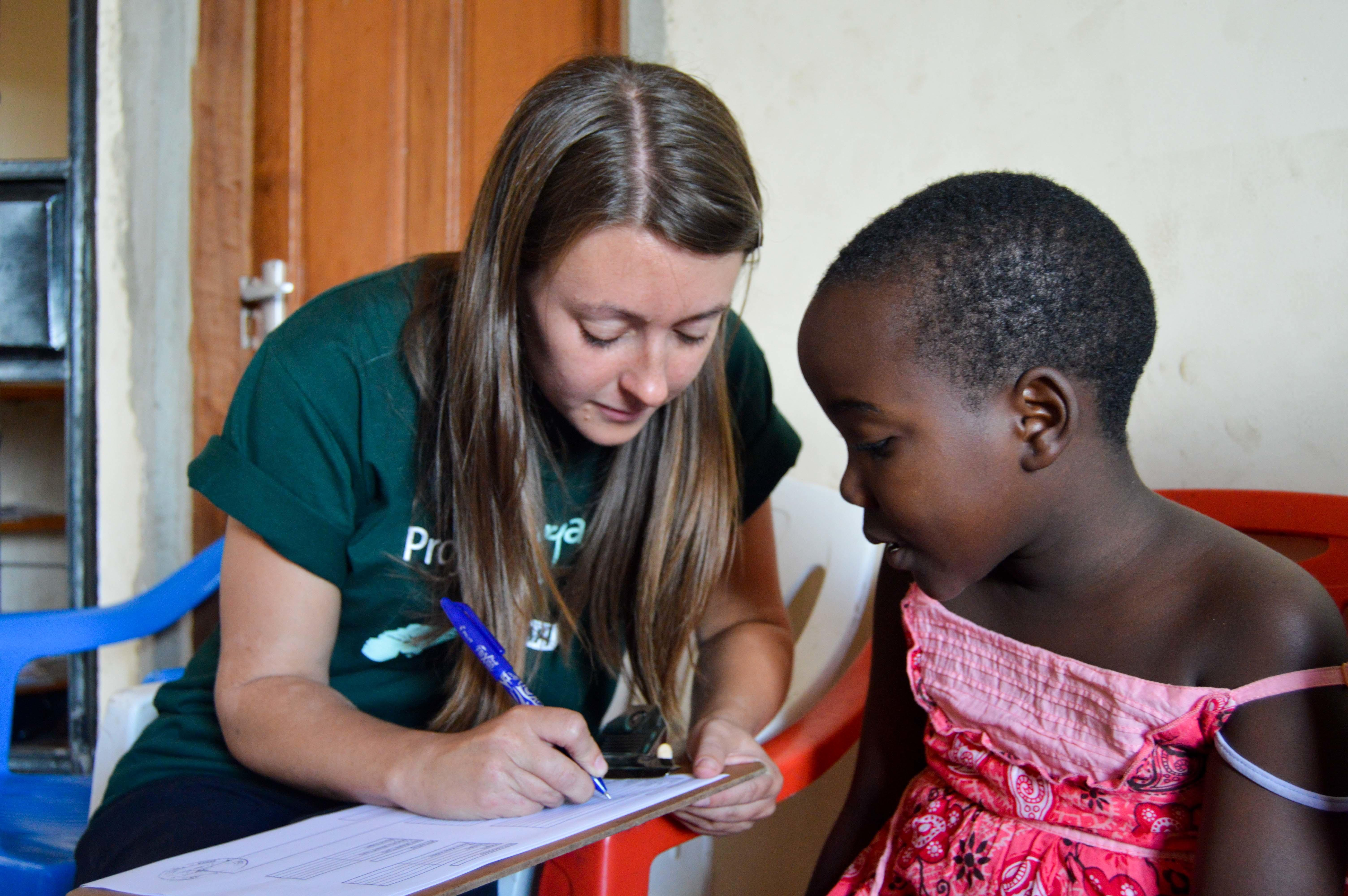 A local girl talks to a student doing her Speech Therapy internship abroad in Tanzania.